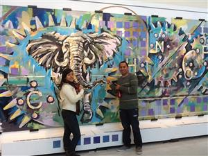 Students point out a mural during tour of Mt. Hood Community College.
