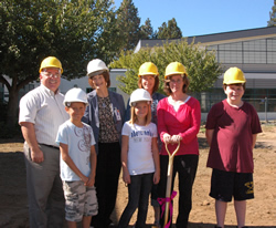 Westside Local Committee member Ann Schlemmer wields the golden shovel as student council members, staff and superintendent join in a groundbreaking ceremony at Westside Elementary School. (Photo by Kirby Neumann-Rae)